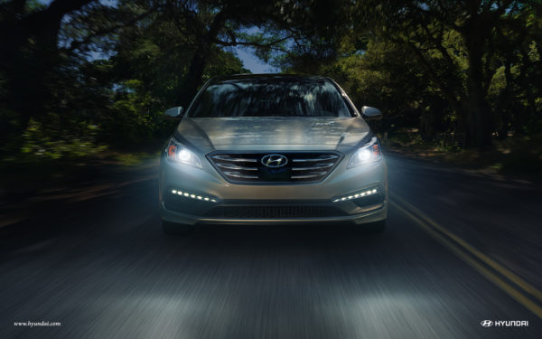 hyundai at night with headlights on