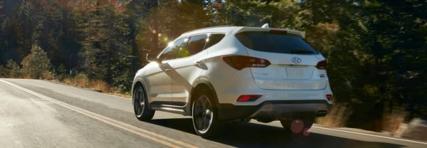 2018 Hyundai Santa Fe Sport driving down the road