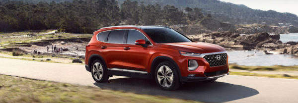 2019 Hyundai Santa Fe driving near a lake