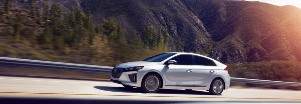 Silver 2019 Hyundai Ioniq Hybrid driving down mountain highway