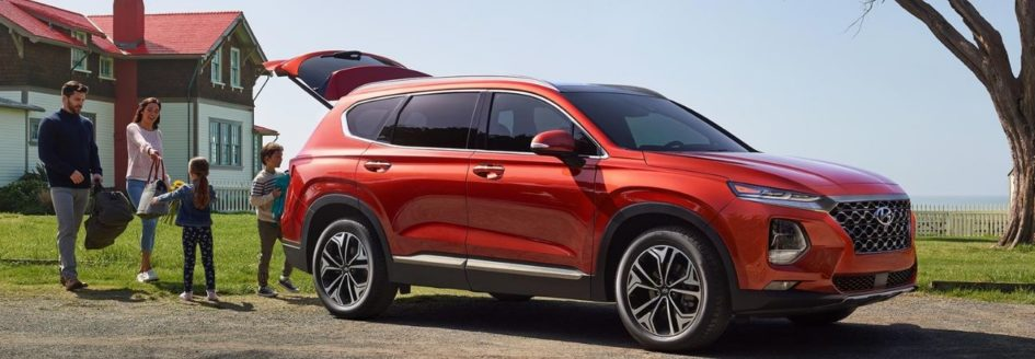 a family packing up into a 2020 hyundai santa fe